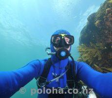 Sidemount scuba diver descending